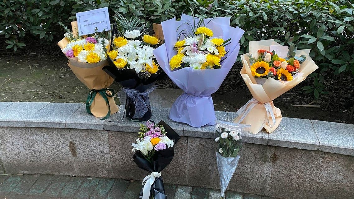 Floral tributes left outside Wuhan Central Hospital in memory of Dr. Li Wenliang, Feb. 7, 2021. (AP/Ng Han Guan)