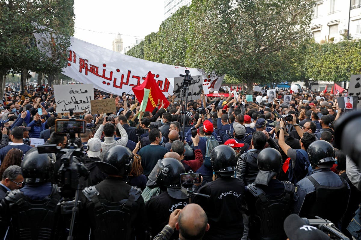 Demonstrators attend a protest to mark the anniversary of a prominent activist's death and against allegations of police abuse, in Tunis, Tunisia February 6, 2021. (Reuters/Zoubeir Souissi)