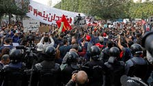Police block large area of central Tunis as thousands protest over unmet demands
