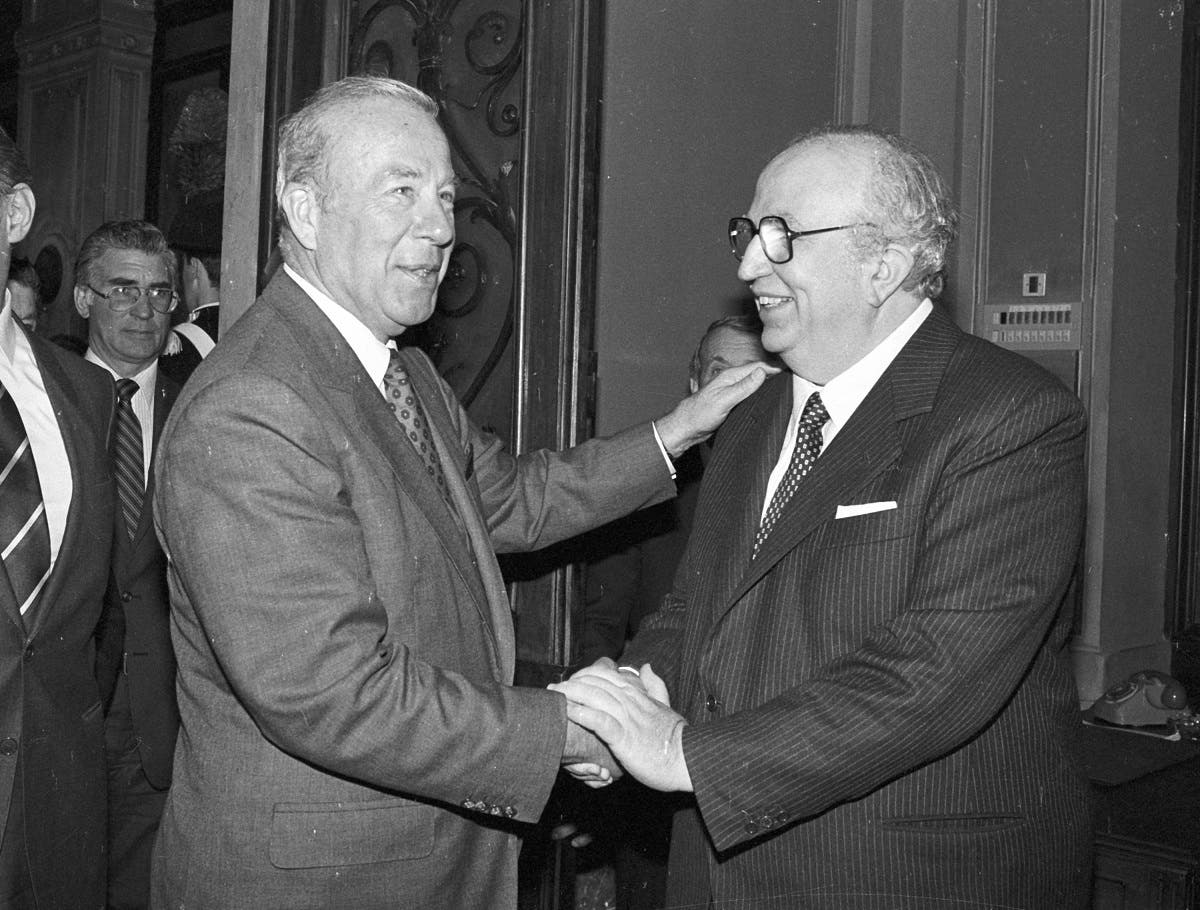 US. Secretary of State George Shultz (L) is greeted by Italian Defense Minister Giovanni Spadolini as he arrives in the latter's office at the Defense Ministry in Rome for talks on March 29, 1986. (Reuters)