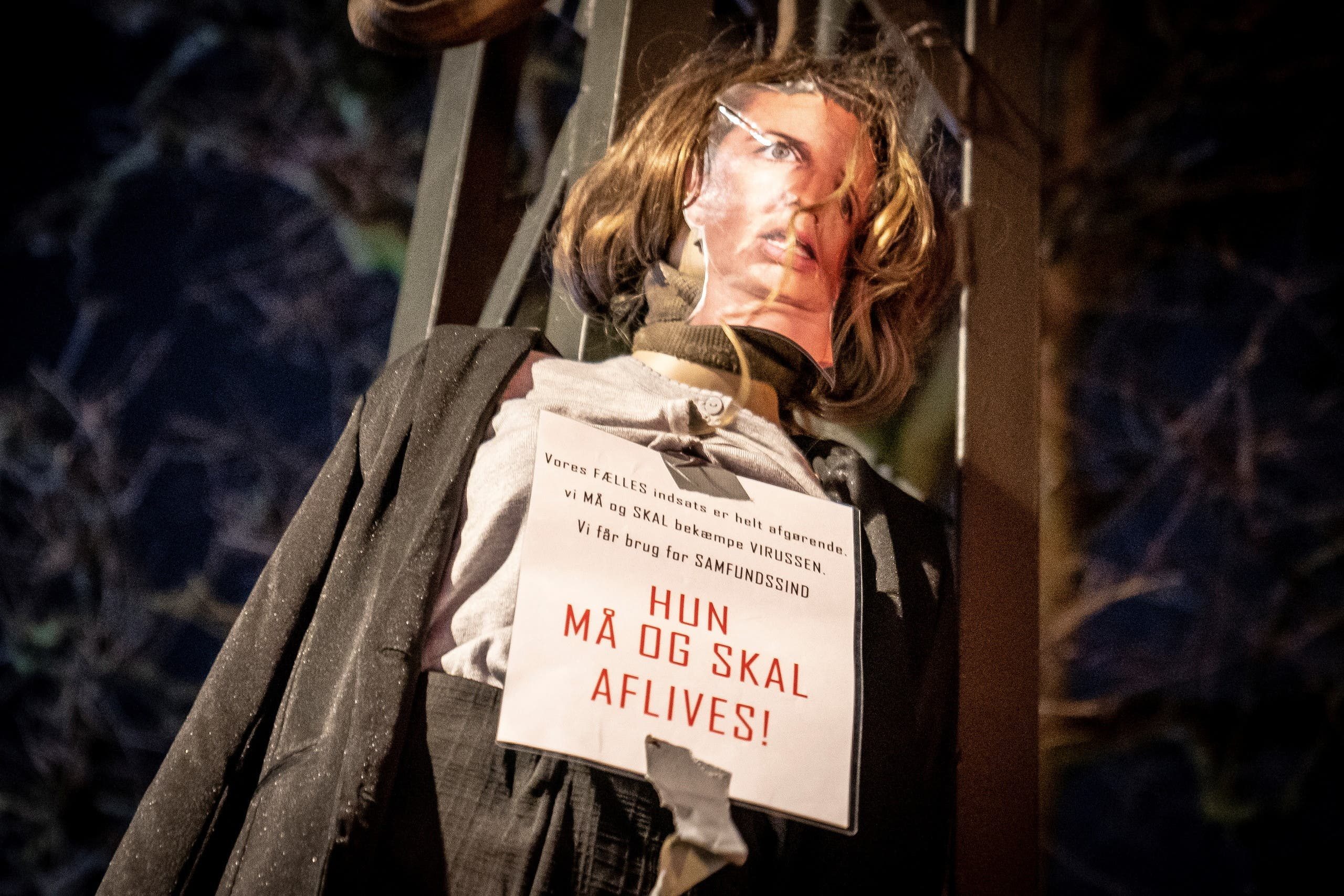 An effigy representing Danish Prime Minister Mette Frederiksen with a sign reading She must be put down hangs on a street in Copenhagen. (Reuters)