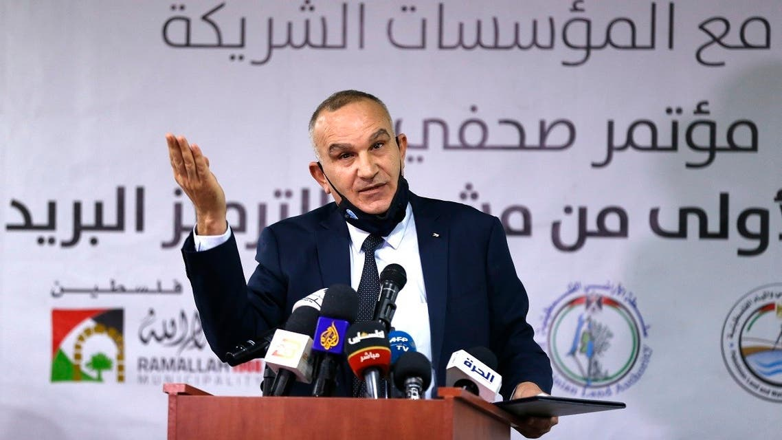 Ishaq Sidr, Palestinian Telecommunications and Information Technology Minister, gives a press conference in the West Bank city of Ramallah on February 7, 2021. (Abbas Momani/AFP)
