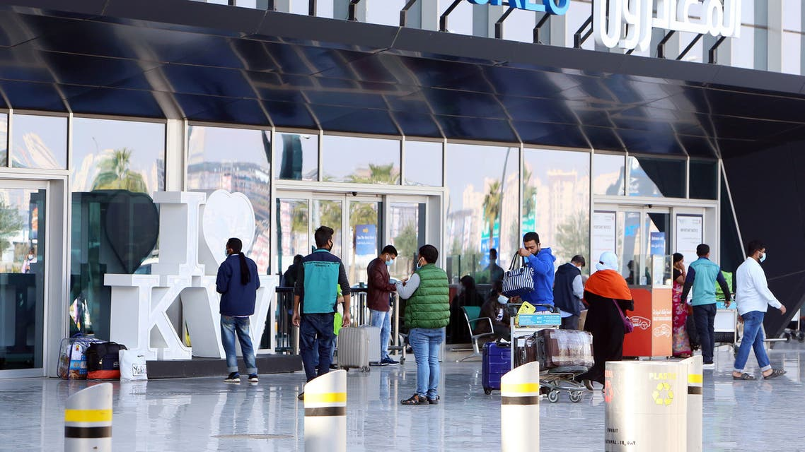 Passengers wait at the departure gate at Kuwait international airport in Kuwait City on January 3, 2021, as the country reopens the airport after a 12-day closure to stem the spread of the COVID-19 pandemic.