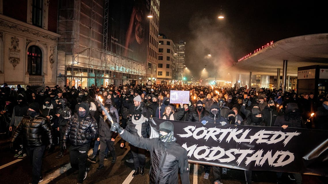 Demonstrators hold a banner reading Black-clad resistance during a protest by a group called Men in Black against COVID-19 restrictions in Copenhagen. (Reuters)