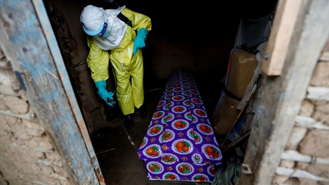 A file photo shows a healthcare worker sprays the coffin of a 85-year-old woman suspected of dying of Ebola, in the eastern Congolese town of Beni, in the Democratic Republic of Congo, October 8, 2019. (Reuters/Zohra Bensemra)