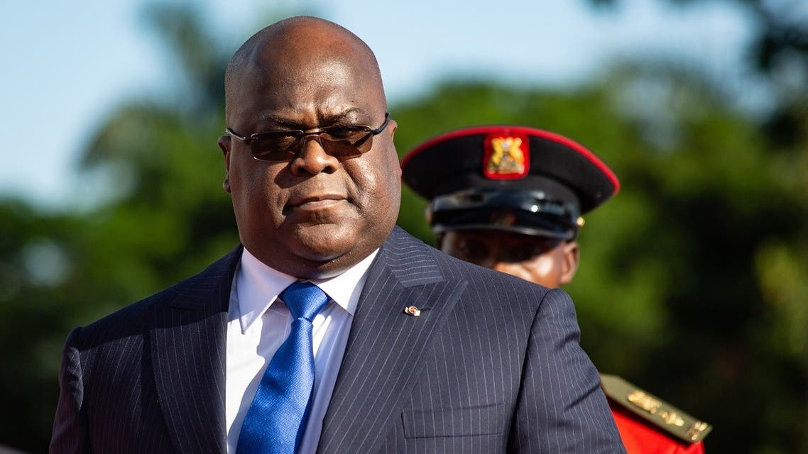 President of Democratic Republic of Congo (DRC) Felix Tshisekedi reviews the guard of honor as he visits Uganda's President Yoweri Museveni to discuss business between the two countries at the state house in Entebbe, Uganda, on November 9, 2019. (Sumy Sadurni/AFP)