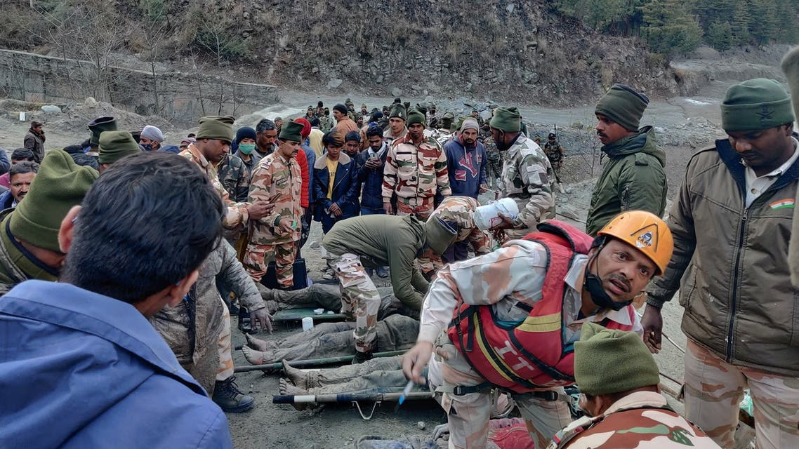 Members of Indo-Tibetan Border Police tend to people rescued after a Himalayan glacier broke and swept away a small hydroelectric dam, in Chormi. (Reuters)