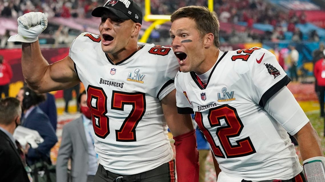 Tampa Bay Buccaneers tight end Rob Gronkowski, left, and quarterback Tom Brady celebrate after defeating the Kansas City Chiefs in the NFL Super Bowl 55 football game Sunday, Feb. 7, 2021, in Tampa, Fla. (AP)