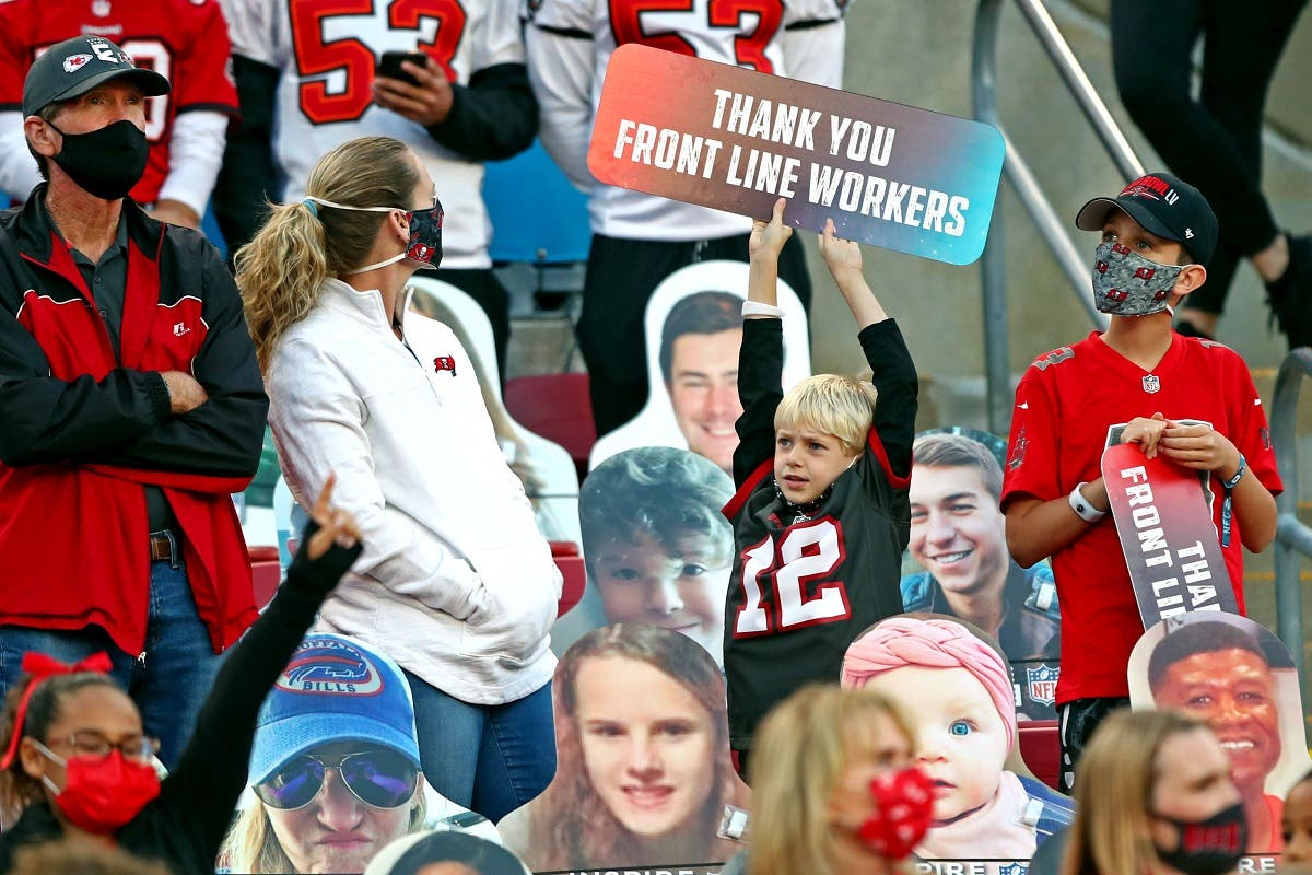 A fan holds a sign thanking front line workers before Super Bowl LV between the Kansas City Chiefs and the Tampa Bay Buccaneers. (Reuters)