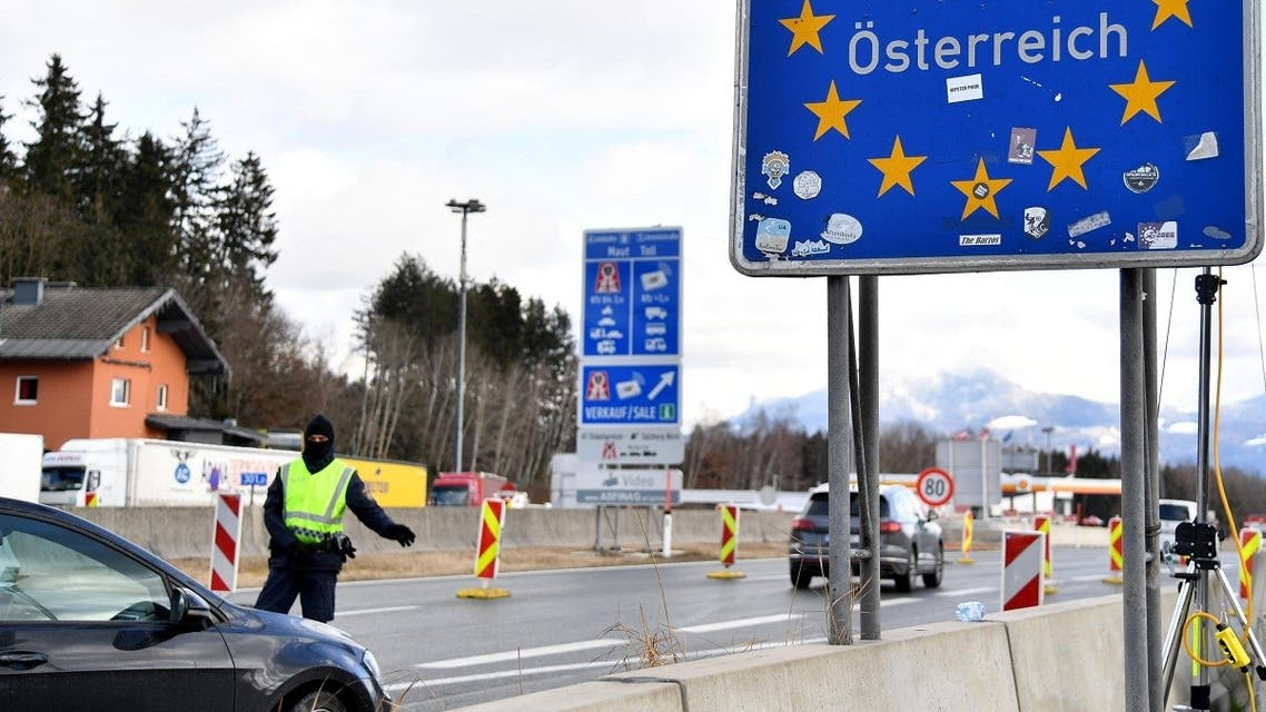 Motorists are checked by police at the Marktschellenberg border crossing near Salzburg as Austria reduces its lockdown restrictions on February 8, 2021 amid the ongoing coronavirus COVID-19 pandemic. (Barbara Gindl/APA/AFP)