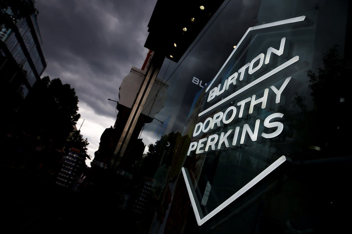 Signage can be seen outside a Burton and Dorothy Perkins store, owned by Arcadia Group, in central London, Britain. (Reuters)