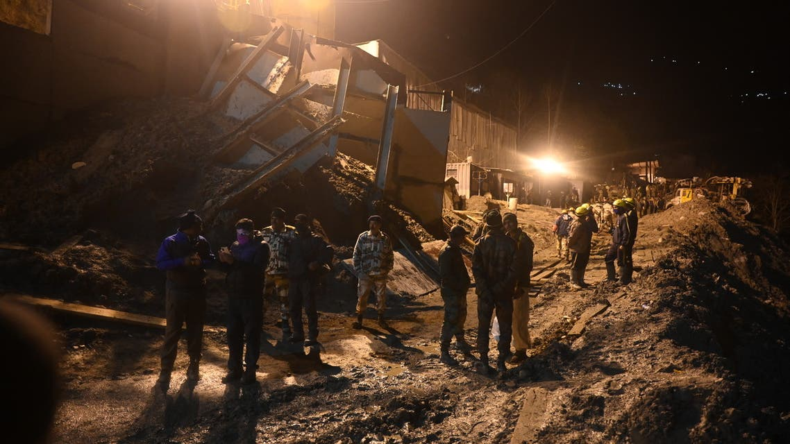 Indian army and rescue teams stand outside the entrance of a tunnel blocked with mud and debris during rescue operations in Tapovan of Chamoli district on February 8, 2021 following a flash flood thought to have been caused when a glacier burst on February 7. (AFP)