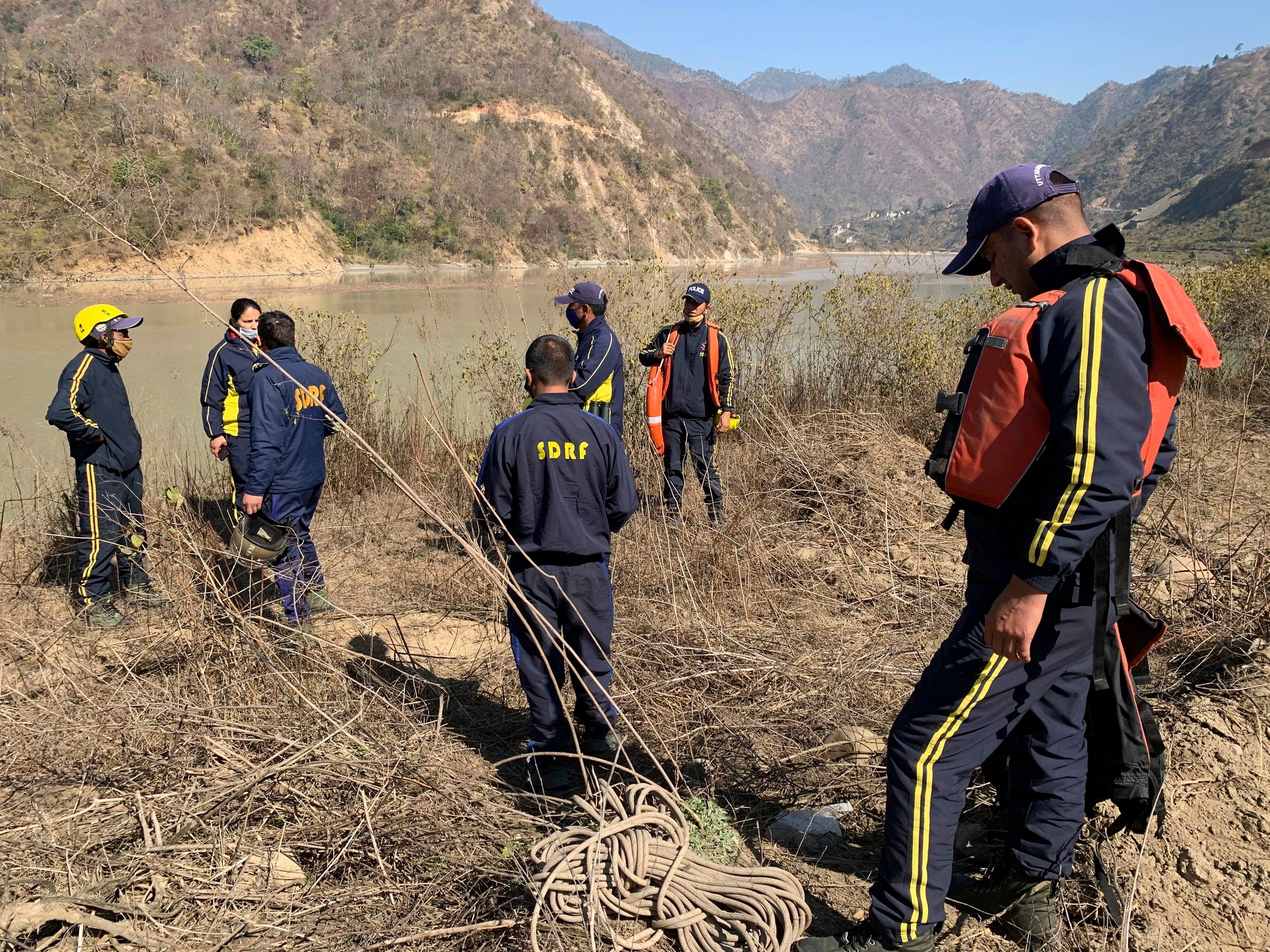 Rescuers prepare to search for bodies in the downstream of Alaknanda River in Rudraprayag, northern state of Uttarakhand, India, Monday, February 8, 2021. (AP)