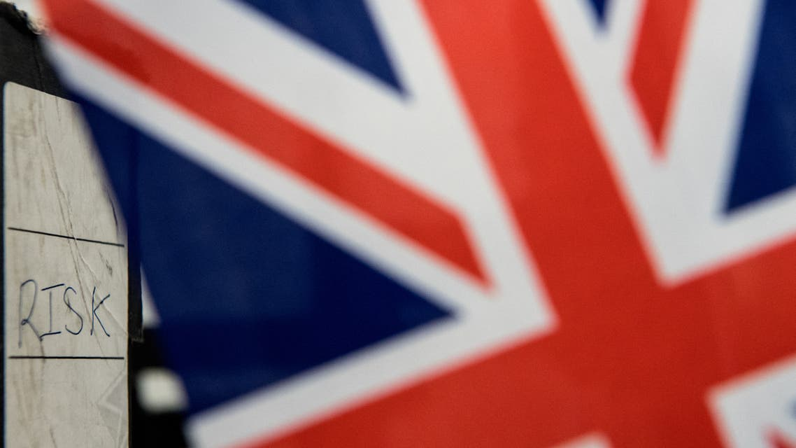 A folder labelled Risk is seen on a desk behind a Union flag. (AFP)