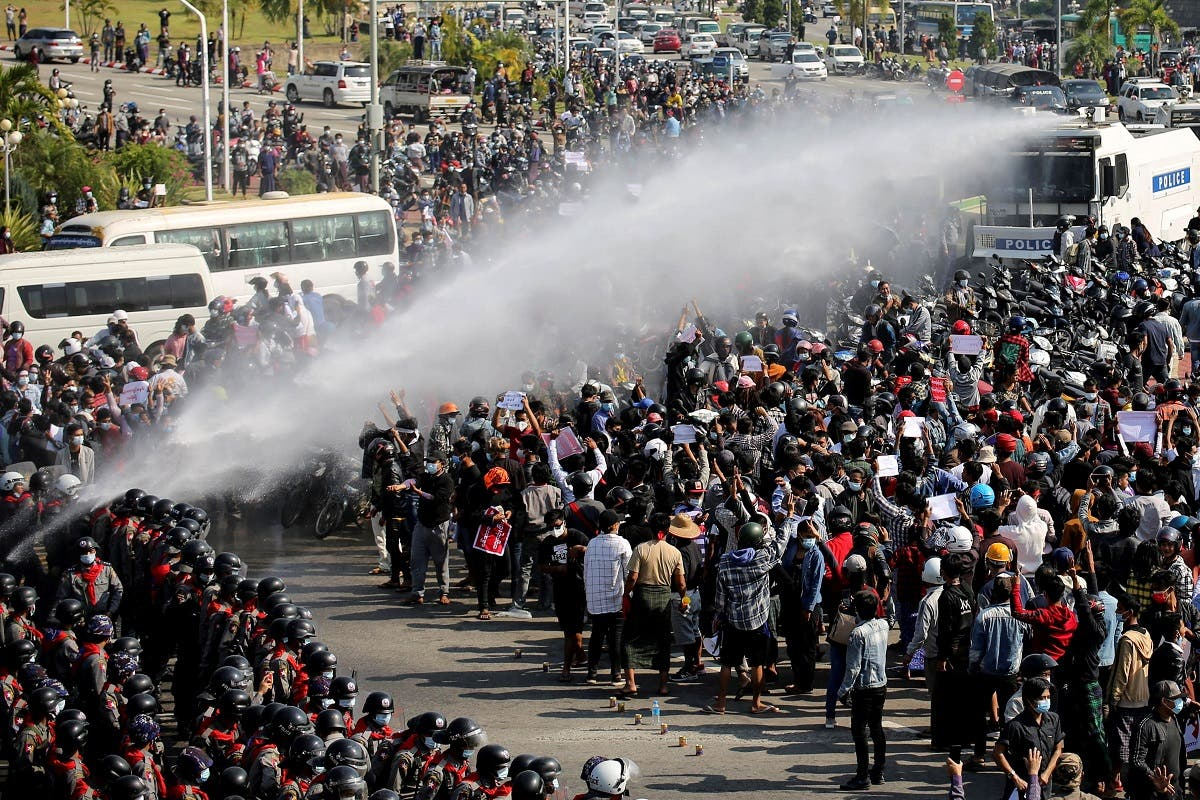 Police fire a water cannon at protesters demonstrating against the coup and demanding the release of elected leader Aung San Suu Kyi, in Naypyitaw, Myanmar, on February 8, 2021. (Reuters)