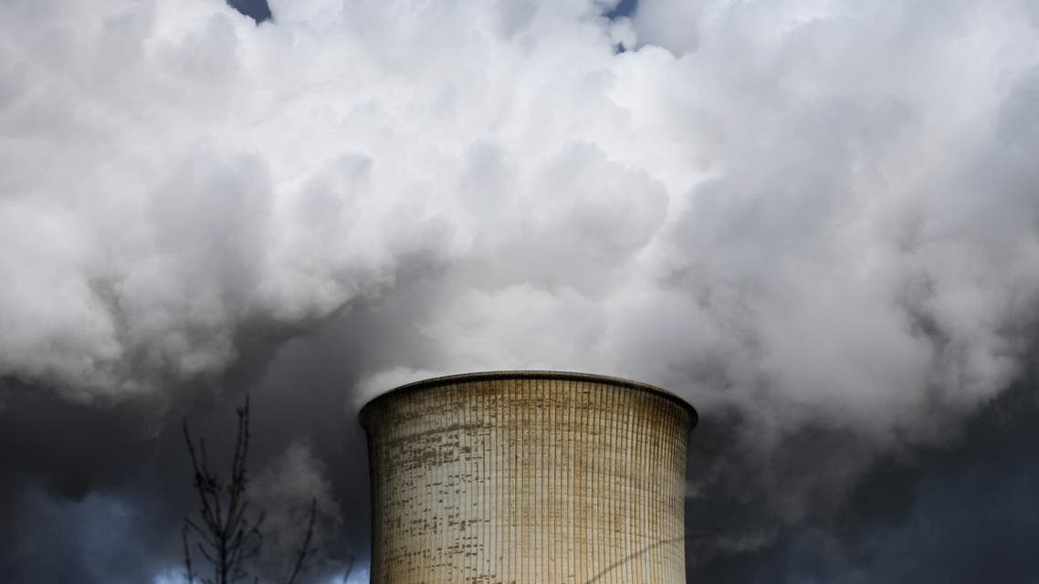 Steam rises from the cooling towers of the coal-fired power station of a factory. (AFP)