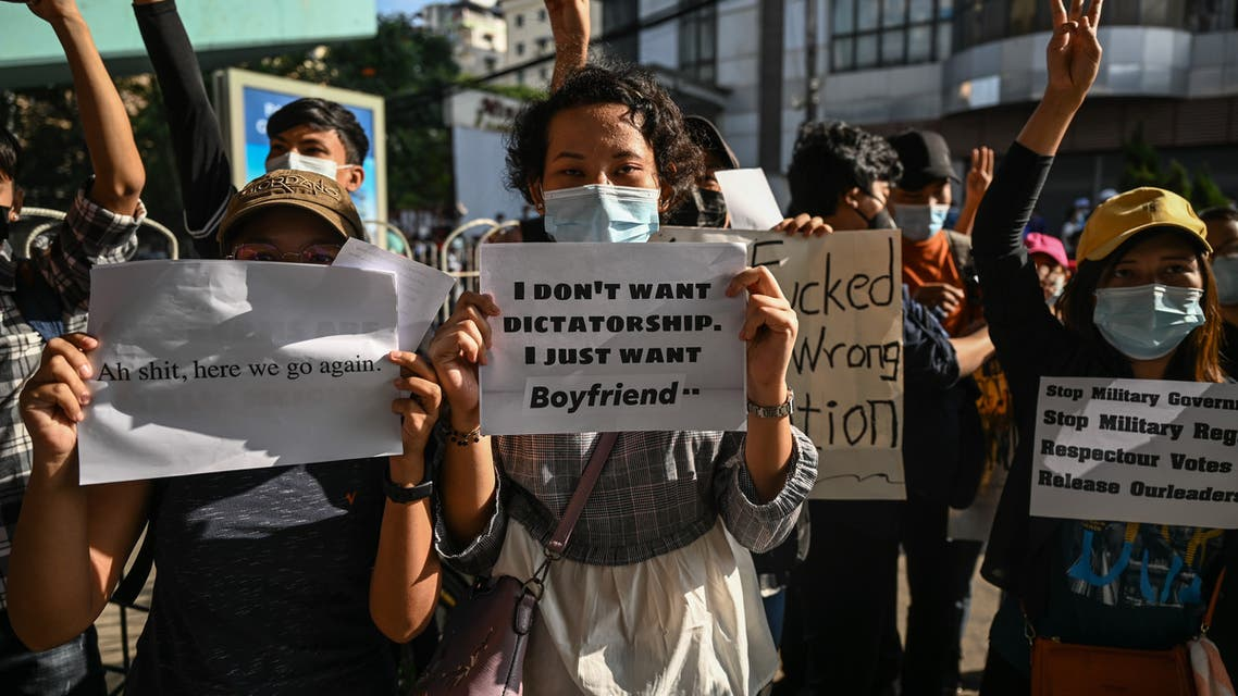 Protesters hold signs denouncing the military during a demonstration against the coup in Yangon on February 8, 2021.  Ye Aung THU / AFP