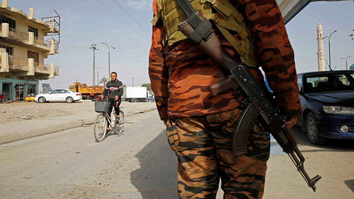 An Iraqi policeman carries a weapon at a checkpoint in Fallujah, Iraq February 3, 2021. Picture taken February 3, 2021. (Reuters)