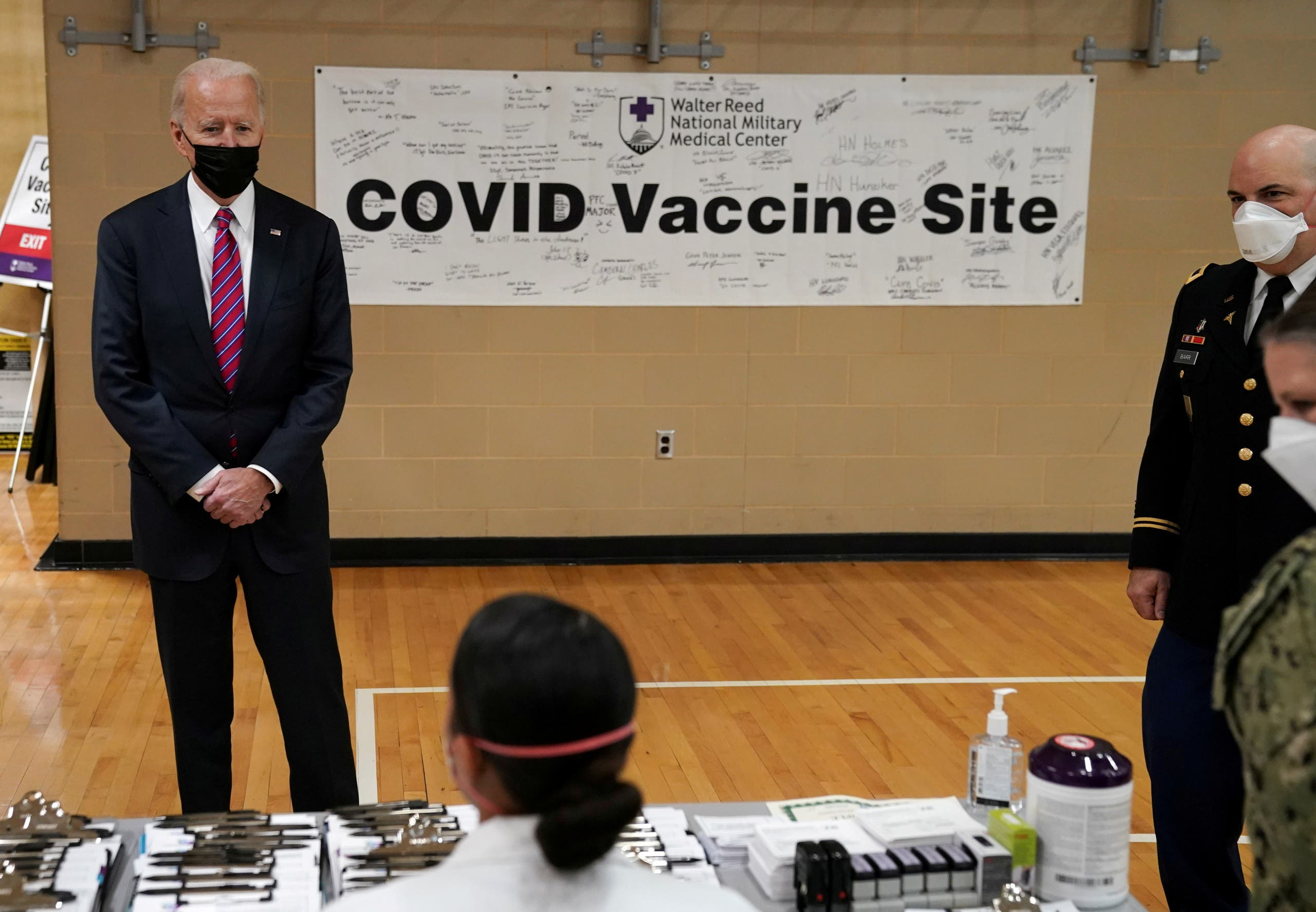 U.S. President Joe Biden visits a coronavirus disease (COVID-19) vaccination site during a visit to Walter Reed National Military Medical Center in Bethesda, Maryland, U.S., January 29, 2021. (Reuters)