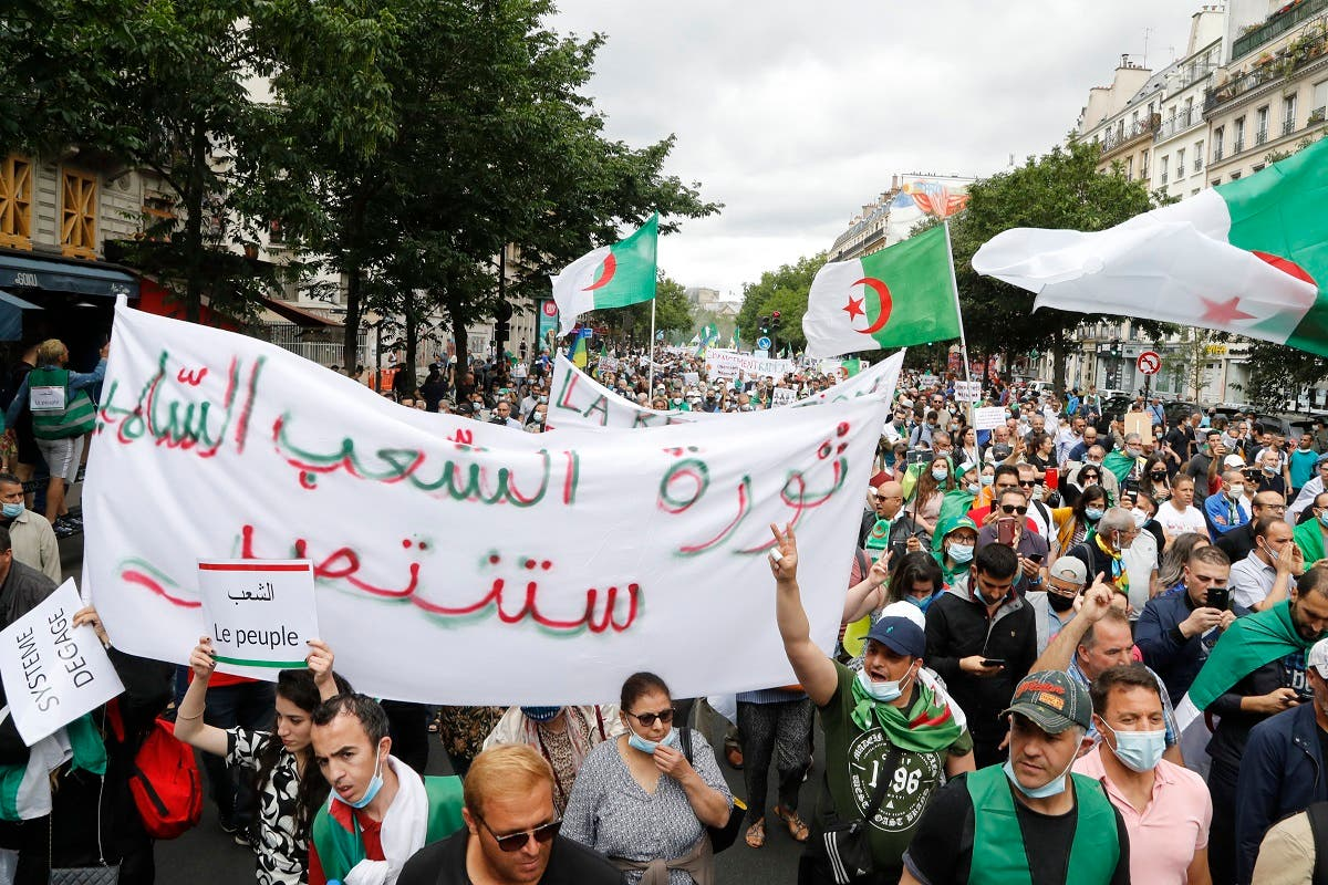 People attend a demonstration in Paris on July 5, 2020 in support of Algeria's Hirak key protest movement as Algeria celebrates today the anniversary of its 1962 independence from France. (File photo: AFP)