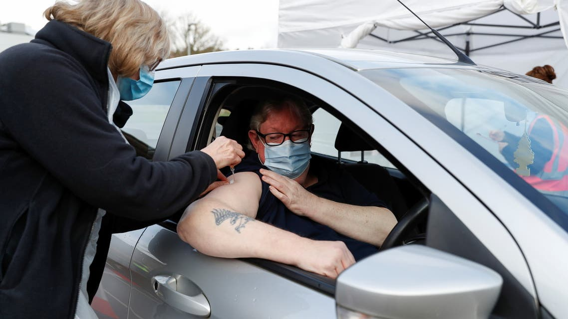 A car driver receives a COVID-19 vaccine at a drive-thru vaccination centre at Batchwood Hall, amid the outbreak of coronavirus disease (COVID-19) in St Albans, Britain, February 5, 2021. REUTERS/Paul Childs