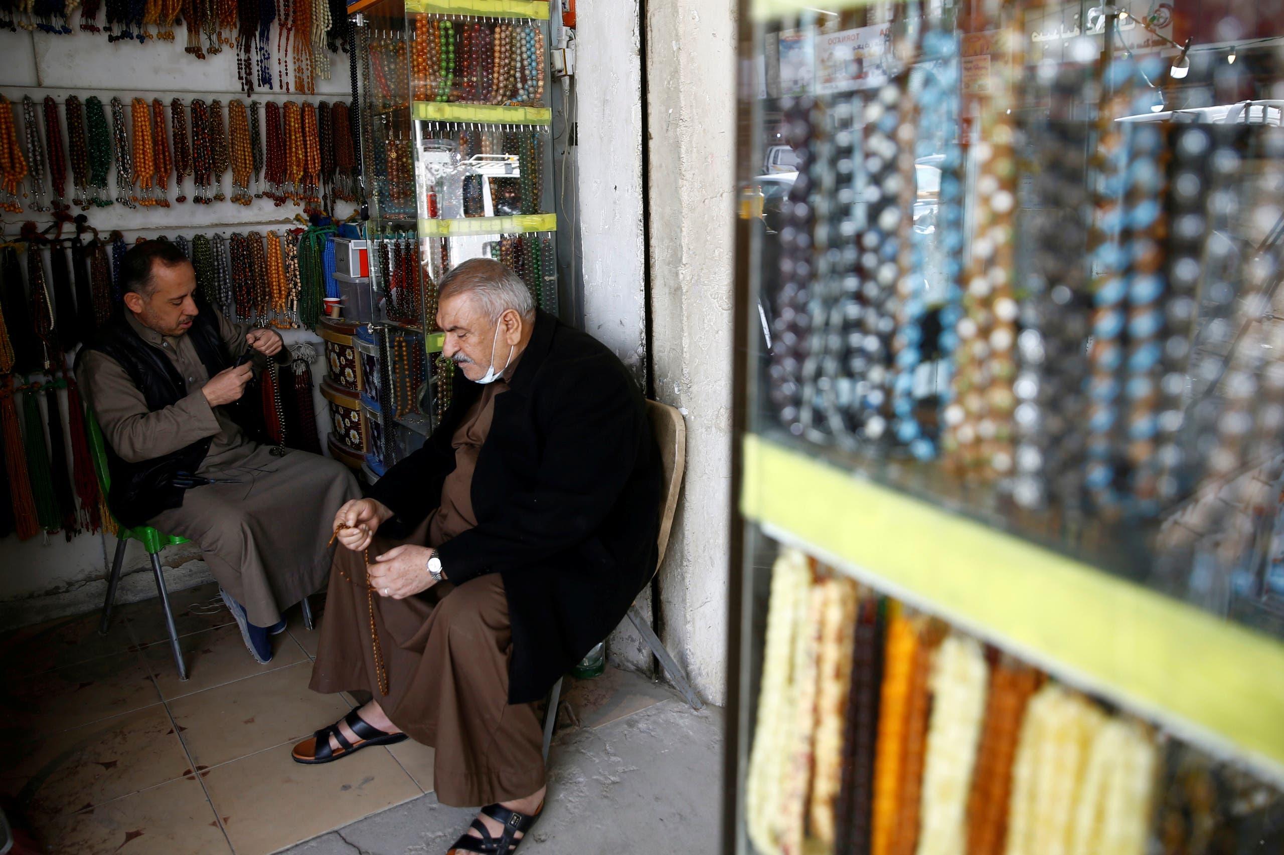 An Iraqi man sells rosaries at a shop in Fallujah, Iraq February 3, 2021. (Reuters)