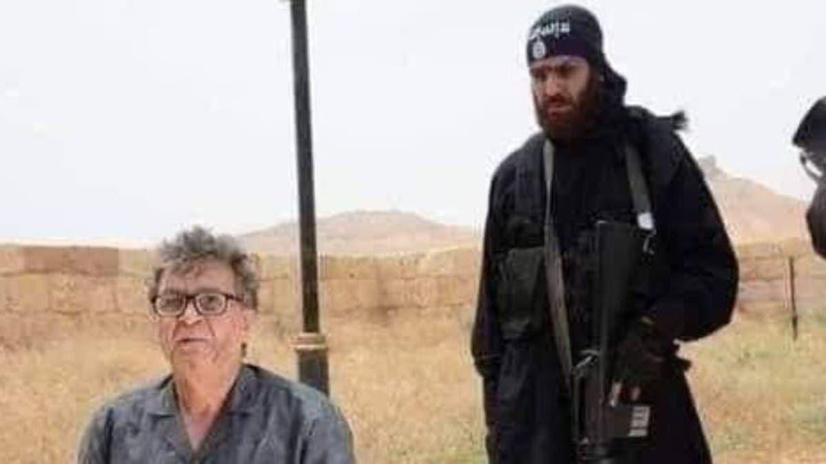 علقه داعش ميتا وهزت صورته العالم.. رفات عالم سوري تظهر