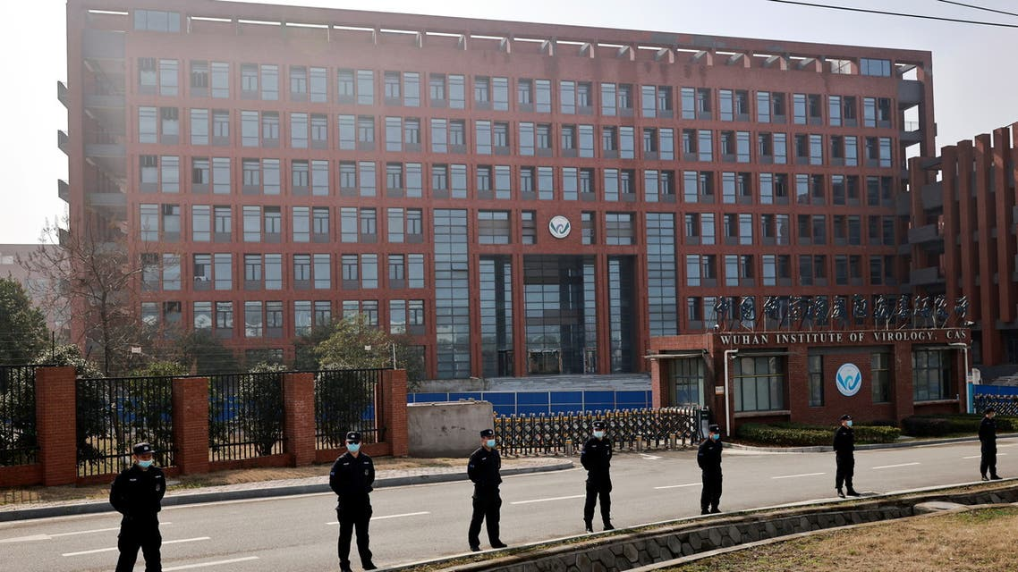 Security personnel keep watch outside Wuhan Institute of Virology during the visit by the World Health Organization (WHO) team tasked with investigating the origins of the coronavirus disease (COVID-19), in Wuhan, Hubei province, China February 3, 2021. REUTERS/Thomas Peter