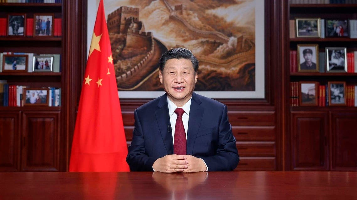 In this photo released by China's Xinhua News Agency, Chinese President Xi Jinping delivers a New Year's address in Beijing, Thursday, Dec. 31, 2020. (Ju Peng/Xinhua via AP)