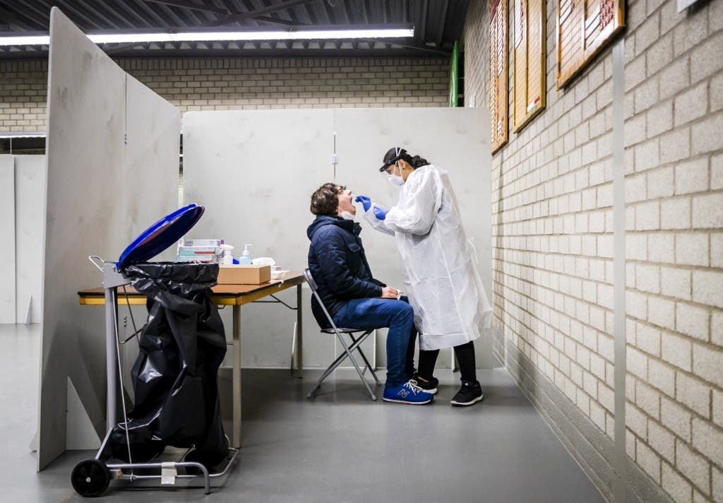 A resident of the Lansingerland municipality gets tested for the Covid-19 in Bergschenhoek, on January 13, 2021, as the UK variant of the disease has been detected. (File photo: AFP)