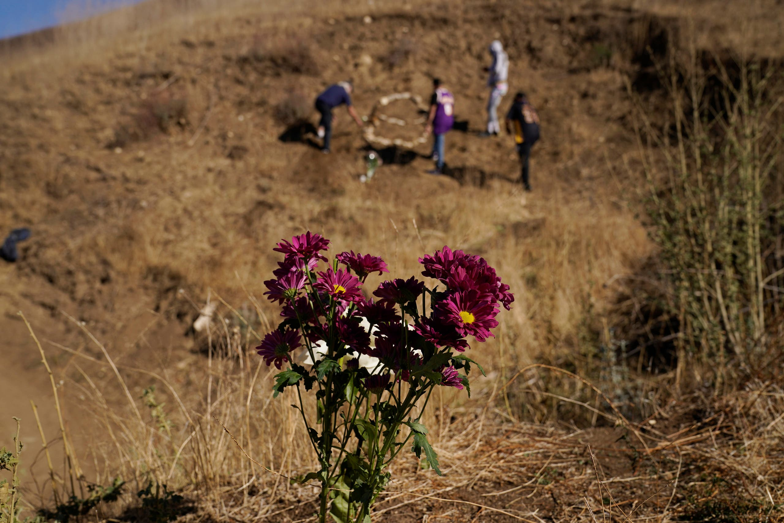 Flowers are placed in honor of Kobe Bryant, Tuesday, Jan. 26, 2021, in Calabasas, Calif., at the site of a helicopter crash that killed Bryant, his daughter Gianna, and seven others one year ago. (AP)