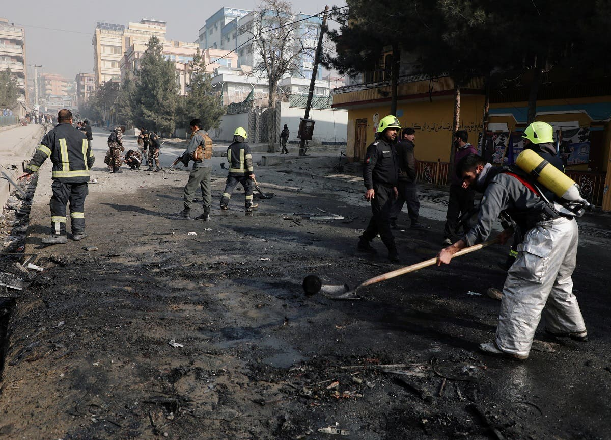 Afghan firefighters remove the remains of a burnt car at the site of a bomb blast in Kabul, Afghanistan January 10, 2021. (Reuters)