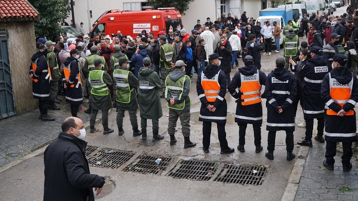 Emergency services gather at the site of illegal underground textile workshop that flooded after heavy rain fall in Morocco's city of Tangiers on February 8, 2021. (AFP)