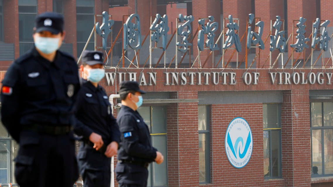 Security personnel keep watch outside Wuhan Institute of Virology, in Wuhan, China Feb. 3, 2021. (Reuters)