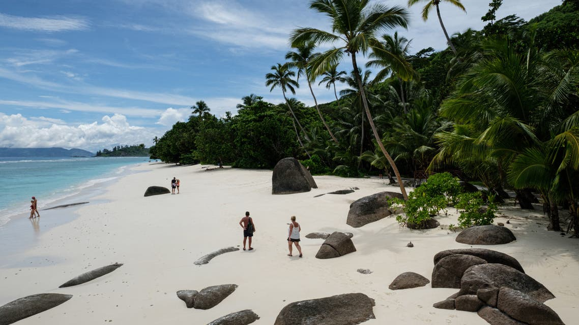 This file photo shows tourists walking on the beach  on in Silhouette Island, Seychelles (File photo: AFP)