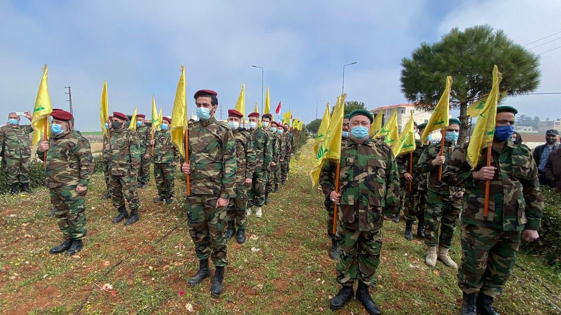 عناصر من ميليشيا حزب الله اللبناني (أرشيفية من فرانس برس)