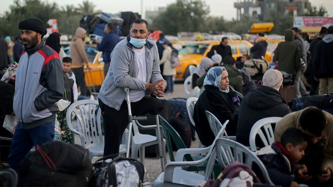 Palestinians wait to leave Rafah border crossing after it was opened by Egyptian authorities, in the southern Gaza Strip February 9, 2021. (Reuters/Ibraheem Abu Mustafa)