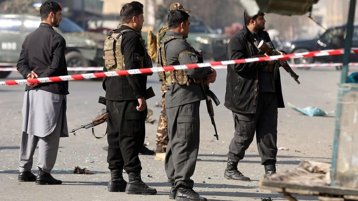 Afghan police officers stand guard at the site of an explosion in Kabul, Afghanistan, on February 6, 2021. (Reuters)