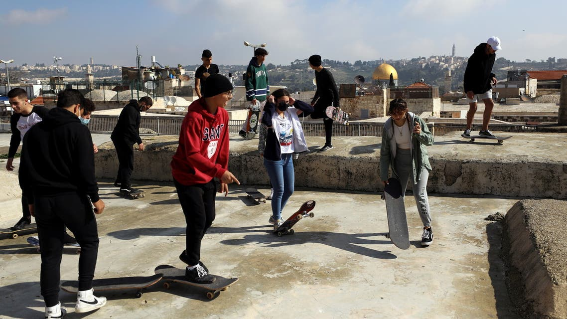 The Dome of the Rock located on the compound known to Muslims as Noble Sanctuary and to Jews as Temple Mount is seen in the background as Palestinian youths skateboard on rooftops, as Israel partially lifts its third national lockdown to fight the coronavirus disease (COVID-19) crisis, in Jerusalem's Old City February 7, 2021. (Reuters)