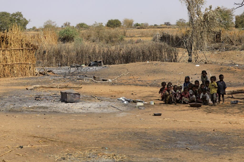 Sudanese children sit together following violence in the village of al-Twail Saadoun, 85 kilometres south of Nyala town, the capital of South Darfur, on February 2, 2021. (AFP)