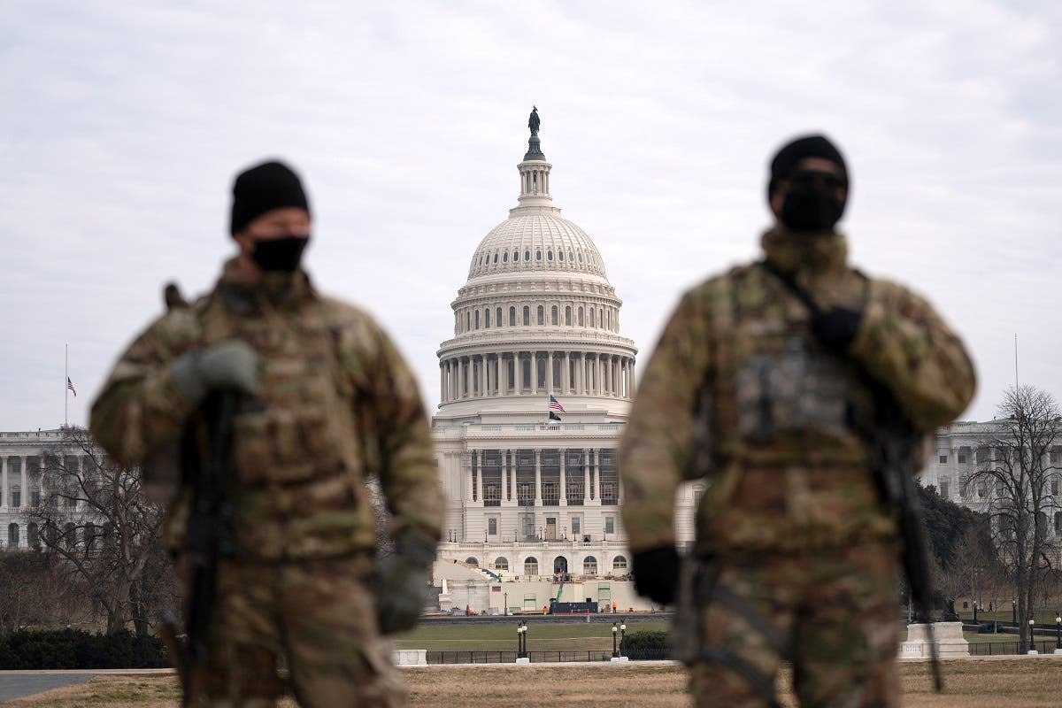 Members of the National Guard patrol the area outside of the Capitol during the impeachment trial of former President Donald Trump, Feb. 10, 2021. (AP)