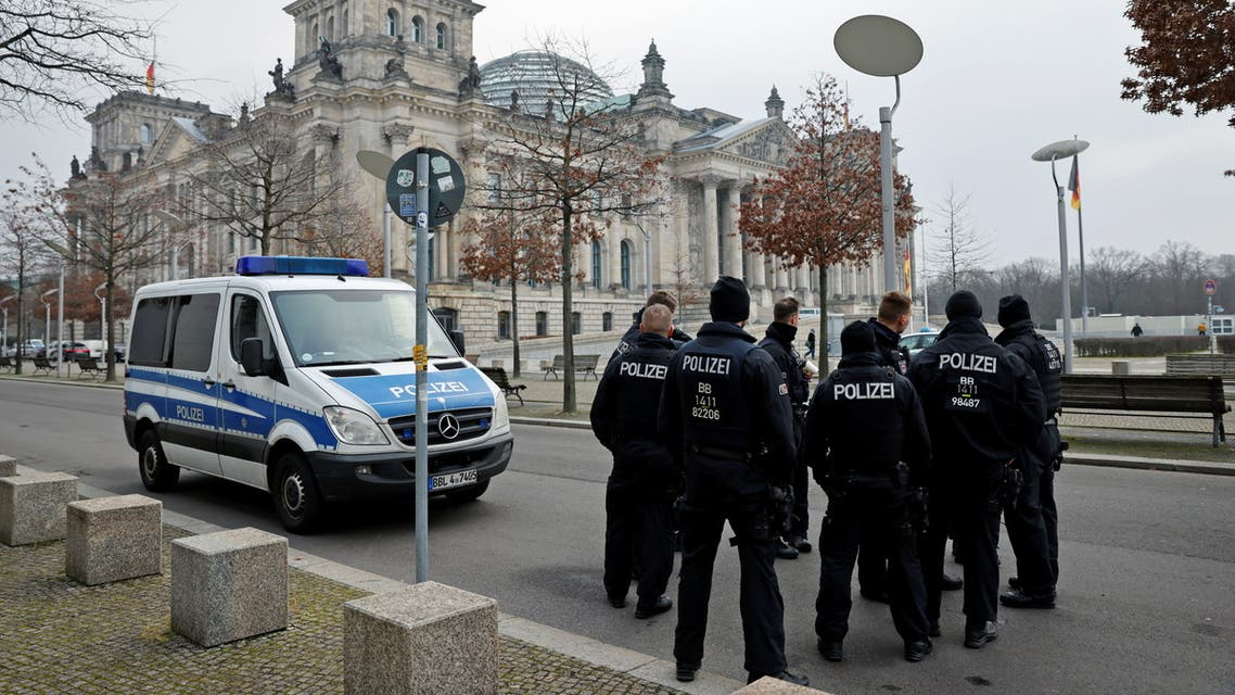 Police officers stand outside Germany's lower house of parliament, the Bundestag building, during the commemoration service for the victims of the Nazi dictatorship, in Berlin, Germany January 27, 2021. REUTERS/Fabrizio Bensch