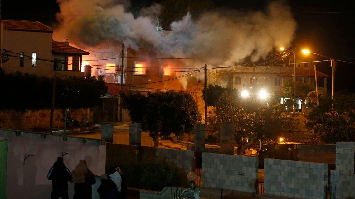 Israeli security forces demolish the house of Palestinian Mohammed Cabha in the West Bank village of Tura al-Gharbiya near Jenin, on February 10, 2021. (Jaafar Ashtiyeh/AFP)