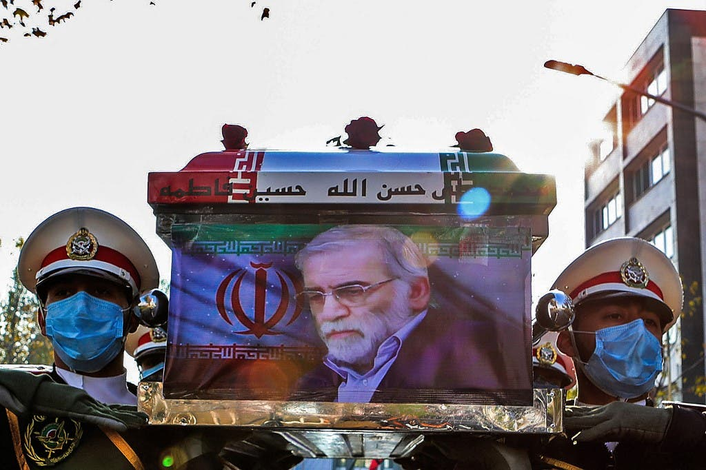 Iranian forces carrying the coffin of slain top nuclear scientist Mohsen Fakhrizadeh during his funeral ceremony in Iran's capital Tehran. (AFP)