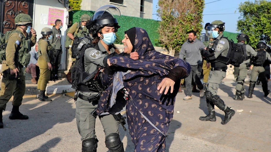 Palestinians clash with Israeli security forces as they prepare to demolish the house of Palestinian Mohammed Cabha in the West Bank village of Tura al-Gharbiya near Jenin, on February 10, 2021. (Jaafar Ashtiyeh/AFP)