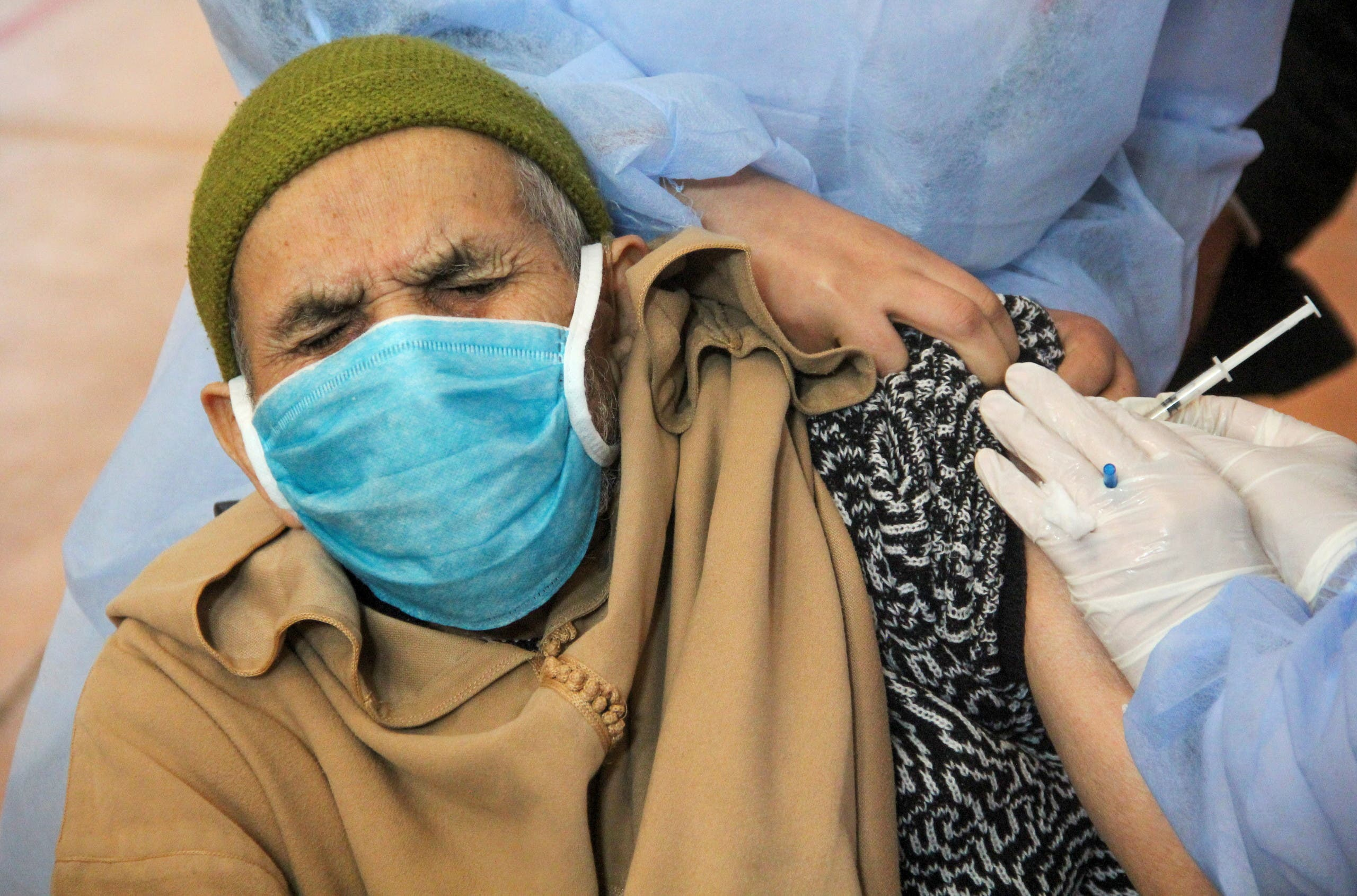 An elderly man receives the COVID-19 vaccine during a national coronavirus vaccination campaign, in Sale. (Reuters)