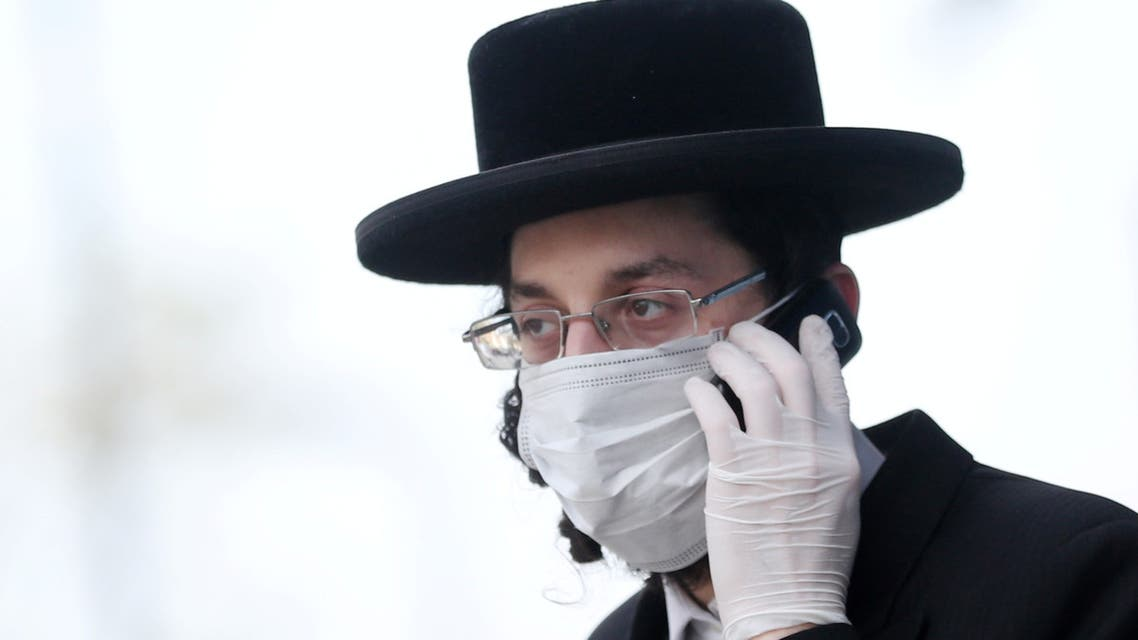 An Orthodox Jewish man wearing a protective face mask and gloves is seen in Stamford Hill, as the spread of the coronavirus disease (COVID-19) continues, London, Britain, April 8, 2020.  (Reuters)