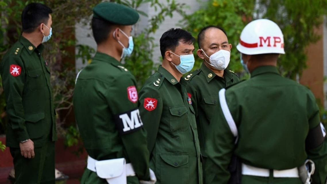 Soldiers arrive at a Hindu temple in Yangon on February 2, 2021, as Myanmar's generals appeared in firm control a day after a surgical coup that saw democracy heroine Suu Kyi detained. (AFP)