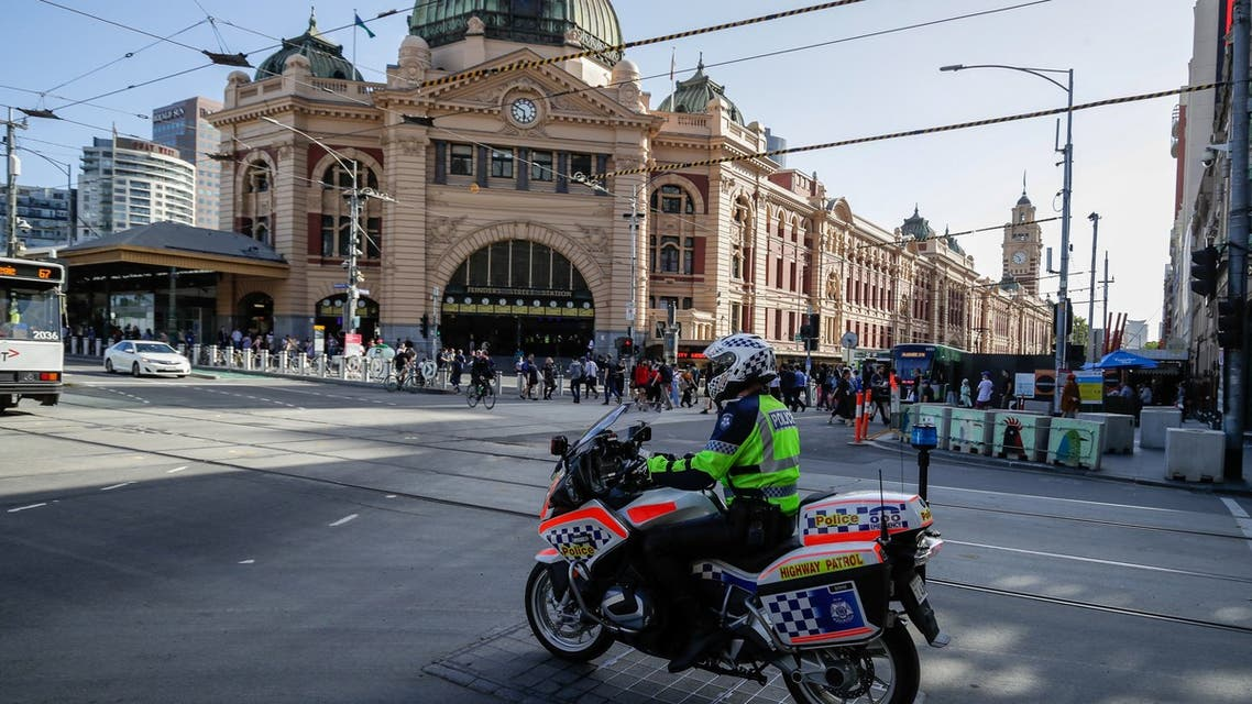 A policeman patrols on a motorcycle in Melbourne on February 12, 2021, after authorities ordered a five-day state-wide lockdown starting at midnight local time to stamp out a new coronavirus outbreak. (AFP)