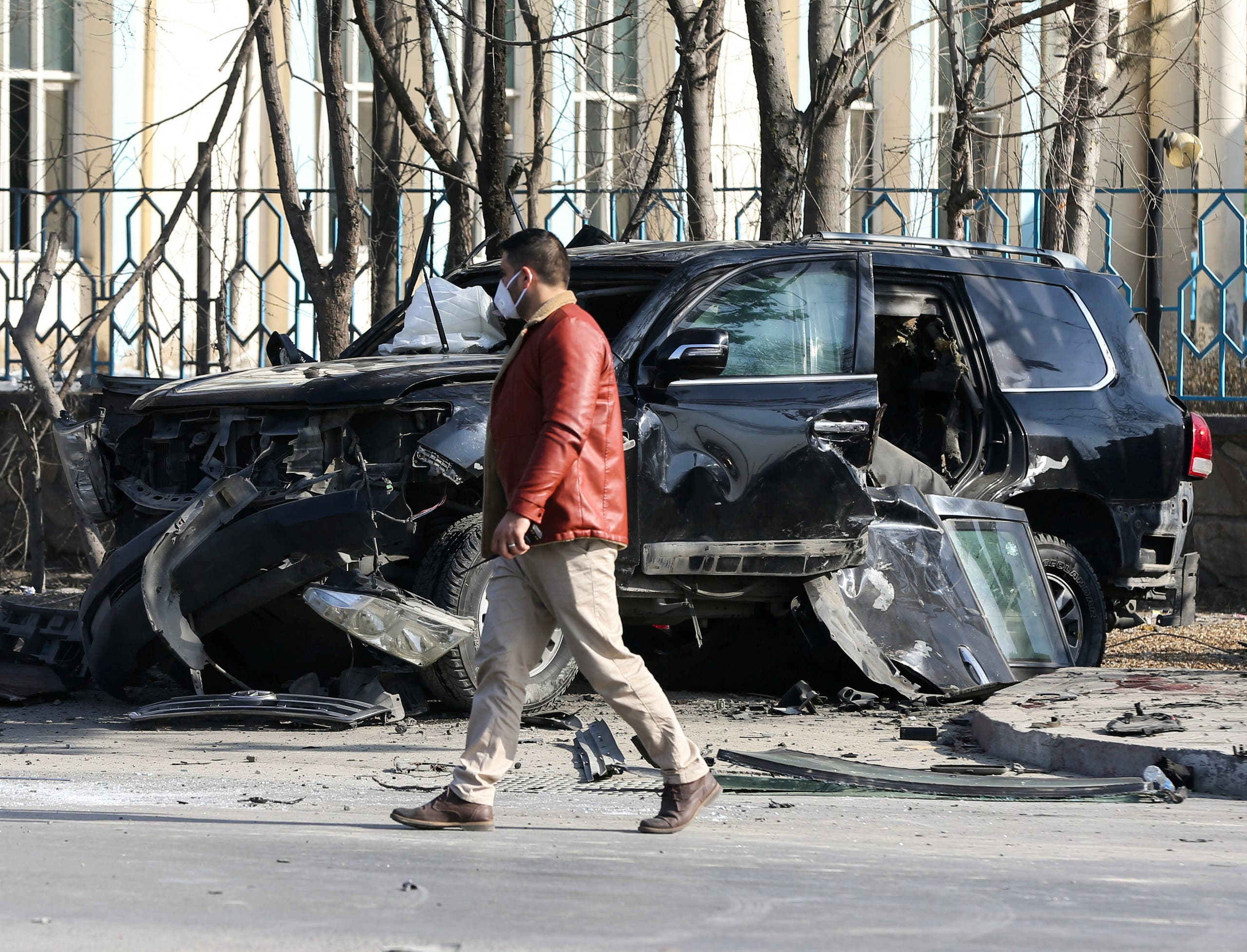 An Afghan security official inspects the site of a bomb blast in Kabul, Afghanistan February 9, 2021. (Reuters/Omar Sobhani)
